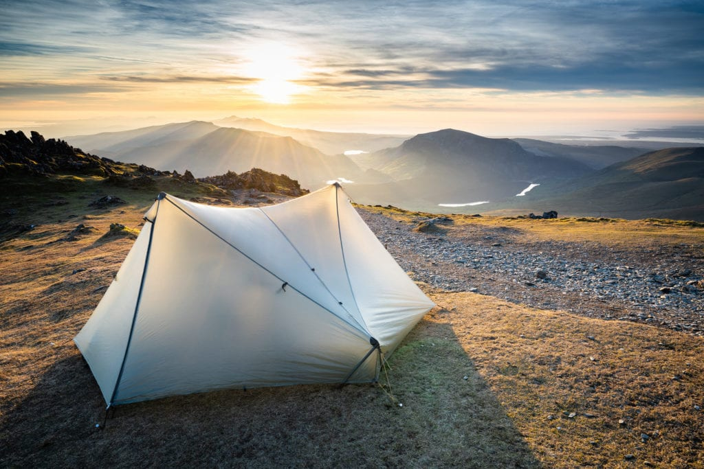 Wild Camping on the summit of sunset for landscape photography