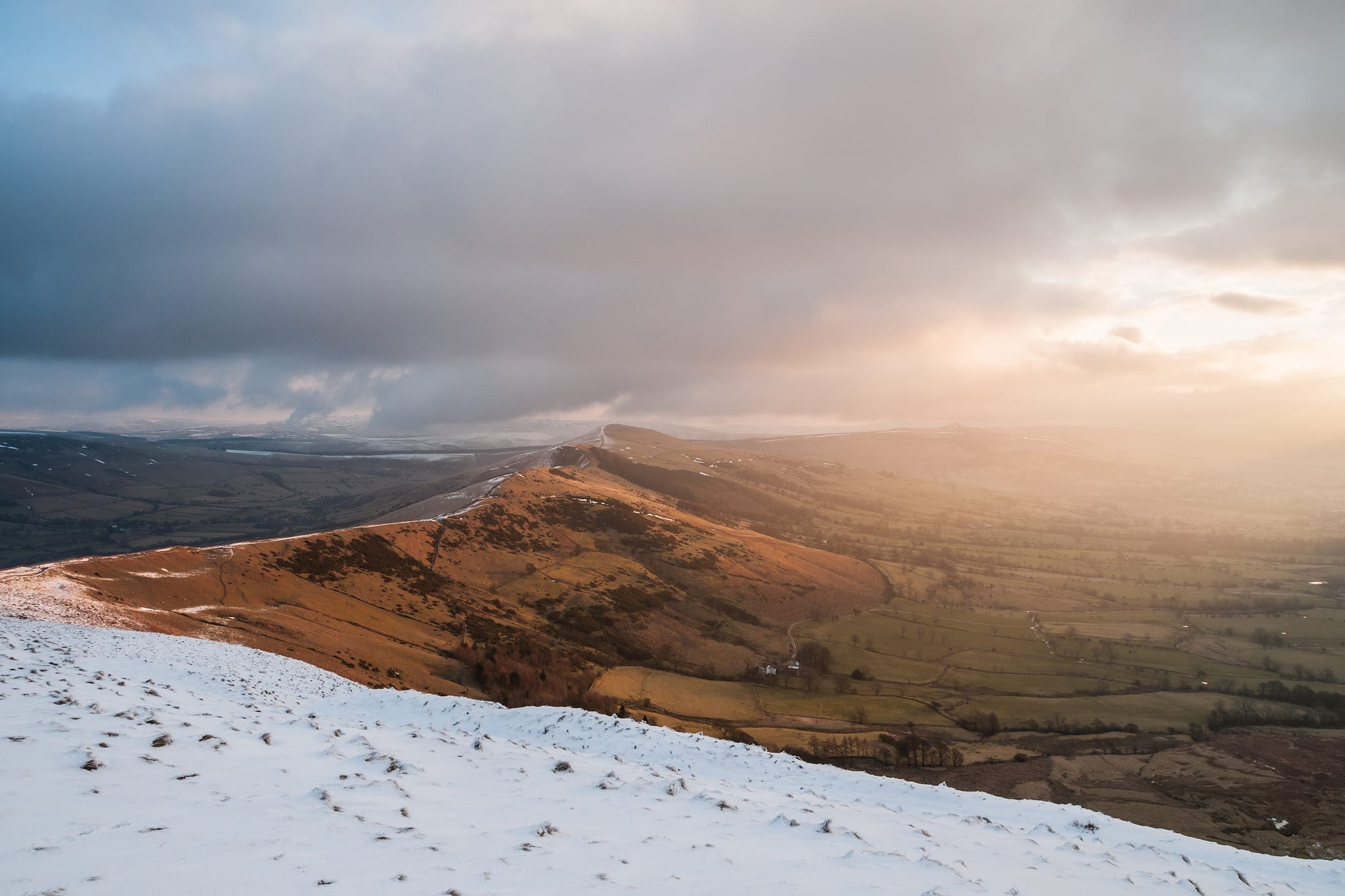 The Great Ridge in winter at sunrise with intense light and snow from just below the summit of Mam Tor - Mam Tor Photography Location Guide.jpg